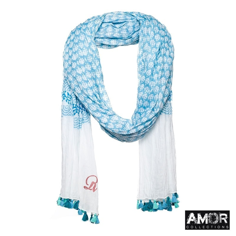 Scarf with all over print and pompoms. Colours: Blue.