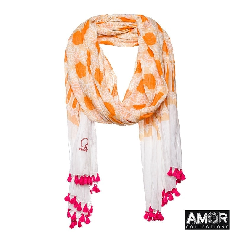 A fresh coloured summer scarf with print and pompoms. Colour: Orange.