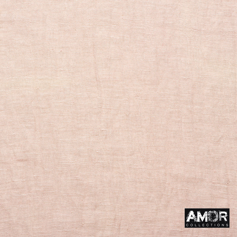 A mix of linen and modal with the pearl beading on the sides. This scarf gets a sporty chique look. Colour: Peach.