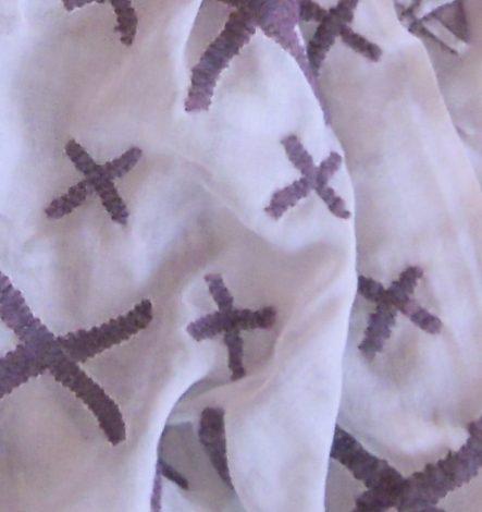 wollen sjaal met borduursel